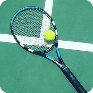 tennis-blue-racket-on-green-court