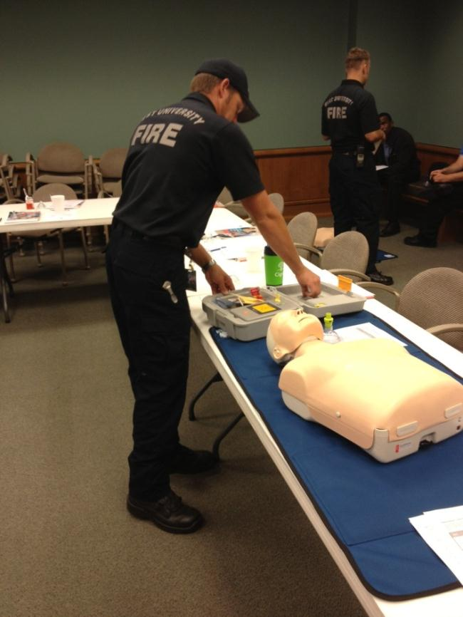 CPR instructor teaching class